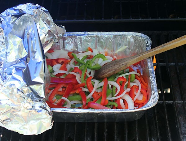 Stirring veggies while cooking on the grill.