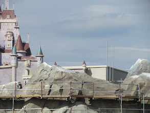 Photo: Part of what will make the Fantasyland expansion so magical is how the land will rise up and surround you on all sides. It will be very heavily landscaped. So I'm hoping that three will be some trees that block this show building that is otherwise plainly visible next to Beasts Castle top the mountains.