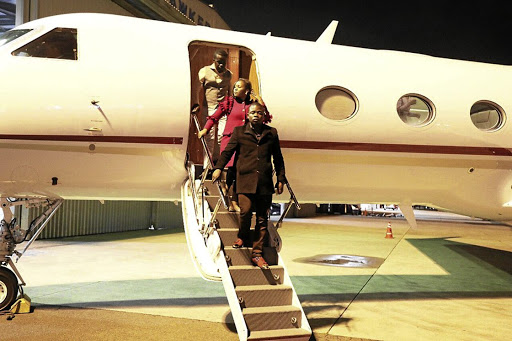Prophet Shepherd Bushiri and his wife Mary disembarking from their private jet.