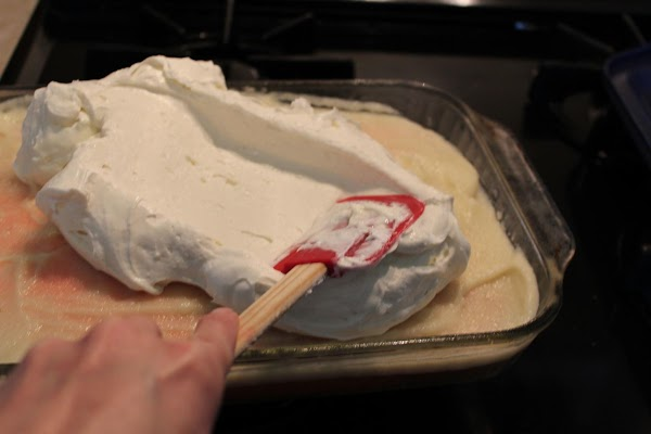 Spread whipped topping on top of the pudding mixture