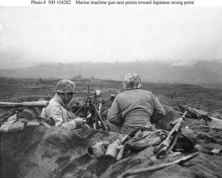 Marine machine gunners on Iwo Jima smoking their pipes.