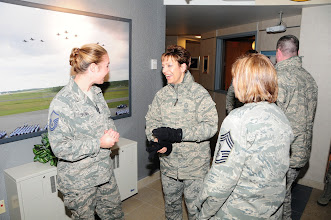 Photo: National Guard Bureau Command CMSgt. Denise Jelinski-Hall shares a laugh during a discussion with MSgt Jennifer Brown and CMSgt Marcia Dumancas after arriving at the 148th Fighter Wing on Nov. 20, 2010 in Duluth Minn.  CMSgt Denise Jelinski Hall came to the 148th FW to host an Airmens Call where she covered subjects such as suicide prevention and the importance family, friends and civilian employers have to the Naional Guard mission.  (U.S. Air Force photo by SSgt Donald Acton)