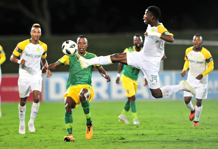 Divine Lunga of Golden Arrows challenged by Phakamani Mahlambi of Mamelodi Sundowns during the Absa Premiership 2018/19 match between Golden Arrows and Mamelodi Sundowns at Princess Magogo Stadium, Durban on 19 September 2018.