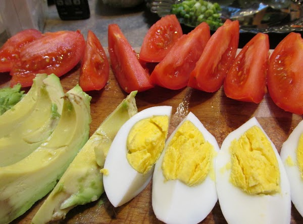 Cut boiled eggs into wedges or slices.Cut Tomatoes into wedges, cut avacadoes into wedges...