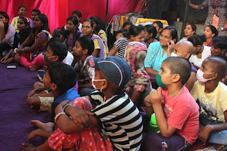 Photo: The children of Gadge Maharaj Dharamshala listening with rapt attention.