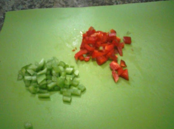 Dice the red onion, green and red peppers, and add to the beans.