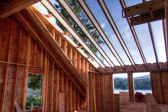 Photo: This one, we installed the sheathing first, nailed to the LVL gable rafter, and then nailed to the common rafter.  Then we installed the studs and then nailed them from the outside.