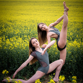 Fields of Gold by Vix Paine - Babies & Children Child Portraits ( beauty, dancers, pose, rapeseed field, dance photography, child dancer, dance move, yellow, ballet, sisters, bare feet, teenagers, flower, dancer, working together, colour, rapeseed, family, sister, child, teenager )