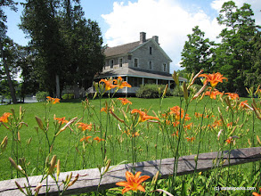 Photo: Split rail fence, flowers and Hawley House at Kingsland Bay State Park