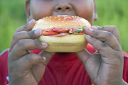 Child obesity has become a health hazard in this country with more people eating junk food, says the writer.