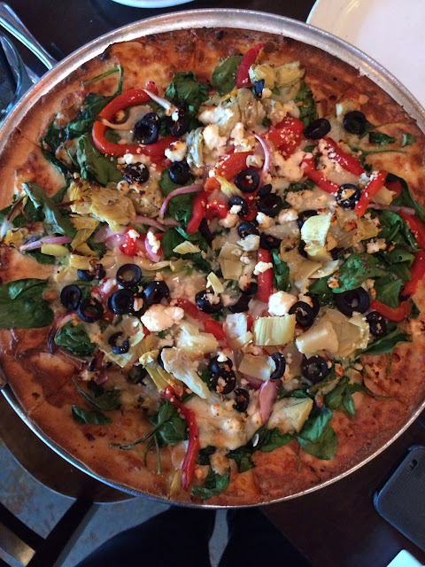Now that I left I forgot the name of this pizza. But it was a white pizza: with red peppers, black olives, artichokes, spinach, red onion, and feta cheese