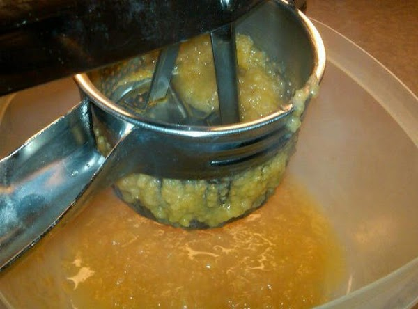 """After four hours apples will be soft and """"saucey"""".  Fill ricer 2/3 full..."""