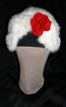 Photo: <KAPELUXE> Unique-Chique Hats by Luba Bilash ART & ADORNMENT  Midnight black wool base; winter white rabbit fur; tomato red wool felt handcrafted flower 360 degree possibilities. Can also be worn on an angle. Size L - 56 cm/22 in $85 SOLD/ПРОДАНИЙ