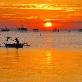 sunset at a fishing village by Greg Crisostomo - Landscapes Sunsets & Sunrises ( village, sunset, still waters, fishing, fisherman,  )