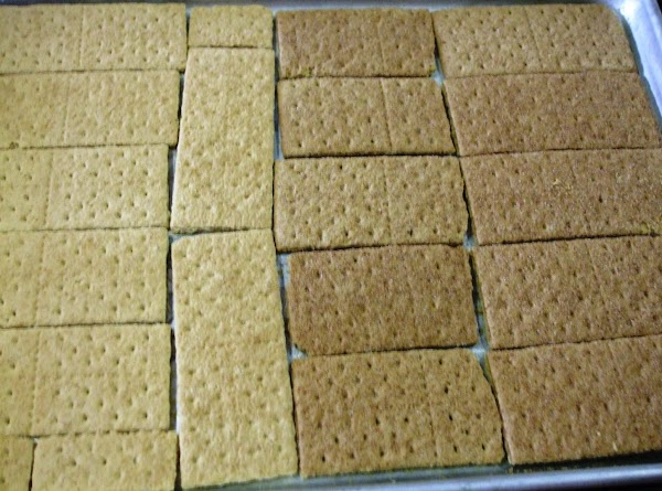 Preheat your oven to 325 degrees F. Lay your graham crackers tightly across the...