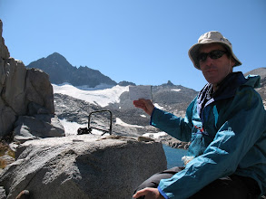 Photo: Pete holds a drawing he made of the glacier, to compare with the glacier's current parameters