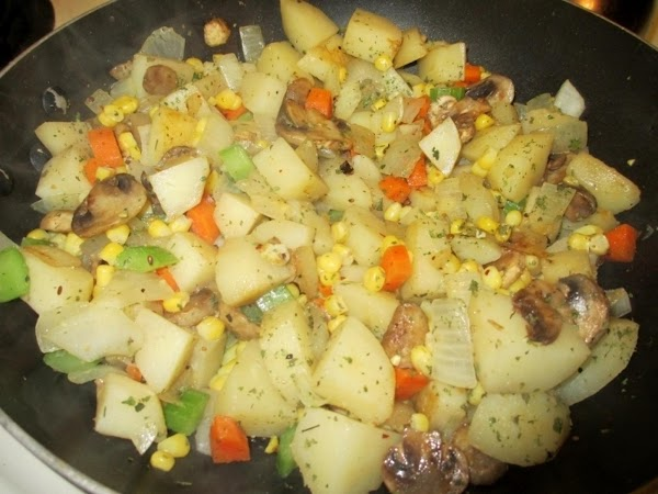 Add olive oil to large frying pan. Add boiled potatoes, onion, carrot, celery, and...