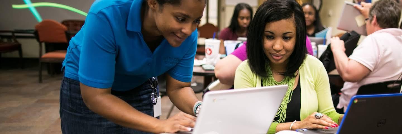 Teachers using a Chromebook