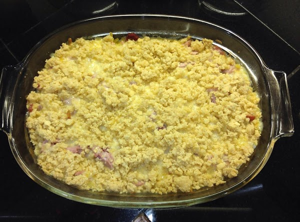 Sprinkle half the ham and cheese mixture over the noodles, then half the soup/milk...