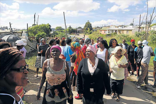 ZINC WARS: Women of Phola Park informal settlement gather to march to Buffalo City Municipality to order a stop to officials harassing them for their zinc sheets. Some 75 families are about to get RDP houses nearby but BCM wants their zinc first Picture: SIBONGILE NGALWA