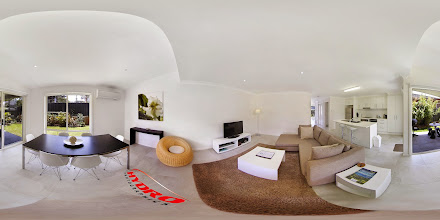 Photo: Executive Townhouse - Downstairs Dining/Living/Patio & Garden www.escapeatnobbys.com.au