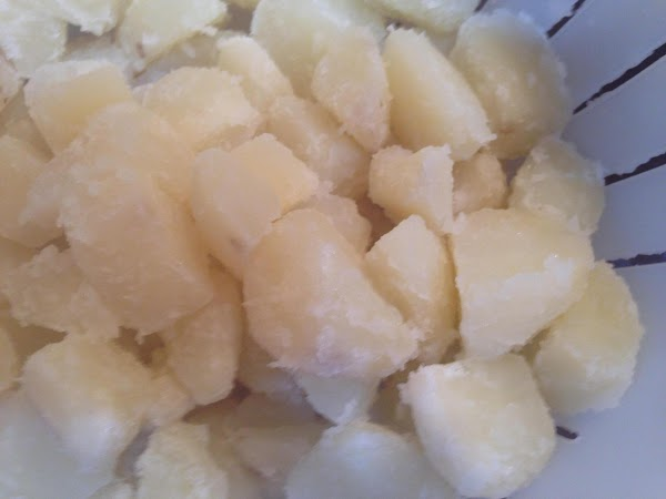 Drain parboiled potatoes into a colander or strainer then shake them around in the...