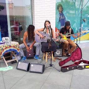 Naia Kete by Tom Carson - City,  Street & Park  Street Scenes ( musicians, reggae, band, dreadlocks, street musicians, street band, guitar, musician )