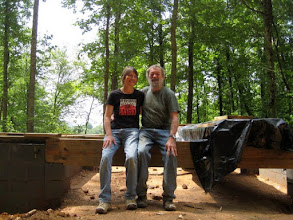 Photo: John and I on the future dogtrot as we move from foundation to floor and walls.