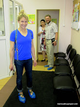 Photo: Liz and Alex Rubtsov don slippers in prep for their shots