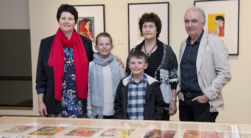 At the opening of the exhibition Peter Chapman Cover Art were Narrabri's Helen Madden, her children Maeve and Jad, their grandmother (and Peter Chapman's widow) Meg Madden and exhibition curator Associate Professor Peter Doyle of Macquarie University.