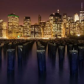 Manhattan sunset by Morten Golimo - City,  Street & Park  Skylines ( manhattan skyline, sunset, pier, long exposure, new york, morten golimo, poles )