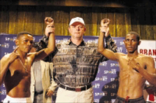 GLADIATORS: Boxing promoter Branco Milenkovic is flanked by South Africa's Silence Mabuza, left, and Colombian Johnny Perez, who will be fighting for the IBF world bantamweight mandatory elimininator at the Springs Indoor Centre, on Friday. 25/05/09. Pic. Mohau Mofokeng. © Sowetan.