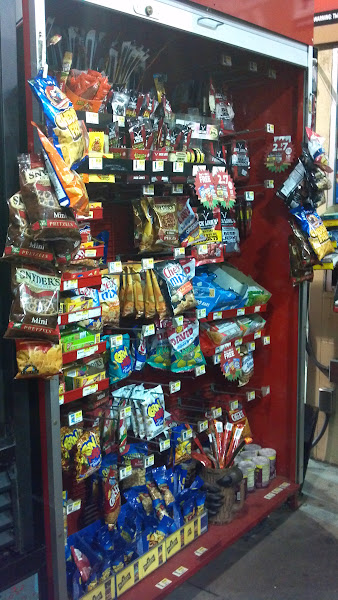 Photo: A nice assortment of snacks such as nuts, beef sticks, crackers, and candy.