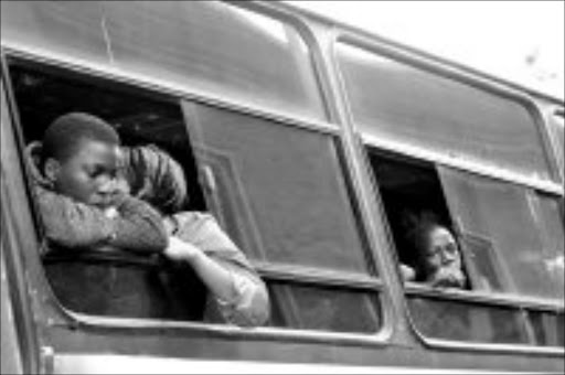 GOING HOME: Displaced foreign nationals from in and around Ekurhuleni boarding busses at the Germiston Civic Centre to take them back to Mozambique. Pic. Mbuzeni Zulu. 21/05/2008. © Sowetan