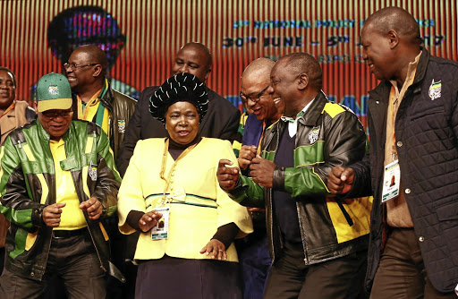 Unity in dance: ANC president Jacob Zuma, left, and his deputy Cyril Ramaphosa, second right, dance with Nkosazana Dlamini-Zuma at the end of the ANC national policy conference held at Nasrec, Johannesburg, in August. Picture: MASI LOSI