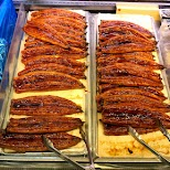 oozing grilled eel, Unagi on sale at Nakano Broadway in Tokyo, Tokyo, Japan