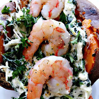 Shrimp and Crab Stuffed Sweet Potatoes with Spinach.