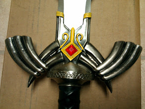 Photo: Closeup of the decorations on the metal Master Sword.
