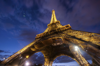 """Photo: Under the Eiffel - Paris, France  This time of night only lasts a fleeting five minutes. So, as a photographer in Paris, it's a major commitment to get in place for that dire period. There's never an easy decision, and... after all... it is Paris, so there is no """"bad"""" place to be.  from the blog www.stuckincustoms.com"""