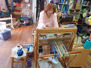 Photo: dressing the loom herself and weaving.....