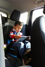Photo: Reading his Bruder catalog, getting ready for his Christmas list. Don't worry, they didn't spend the whole drive cooped up in the car