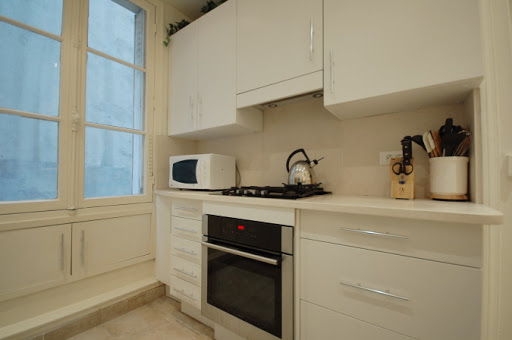 Full kitchen at Rue Jean du Bellay Apartments