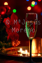 Photo: cup of champagne, with  with colored circles bokeh