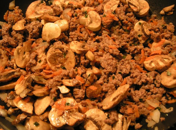 Brown ground beef.  In another sauce pan, sauté onions, garlic and mushrooms until...