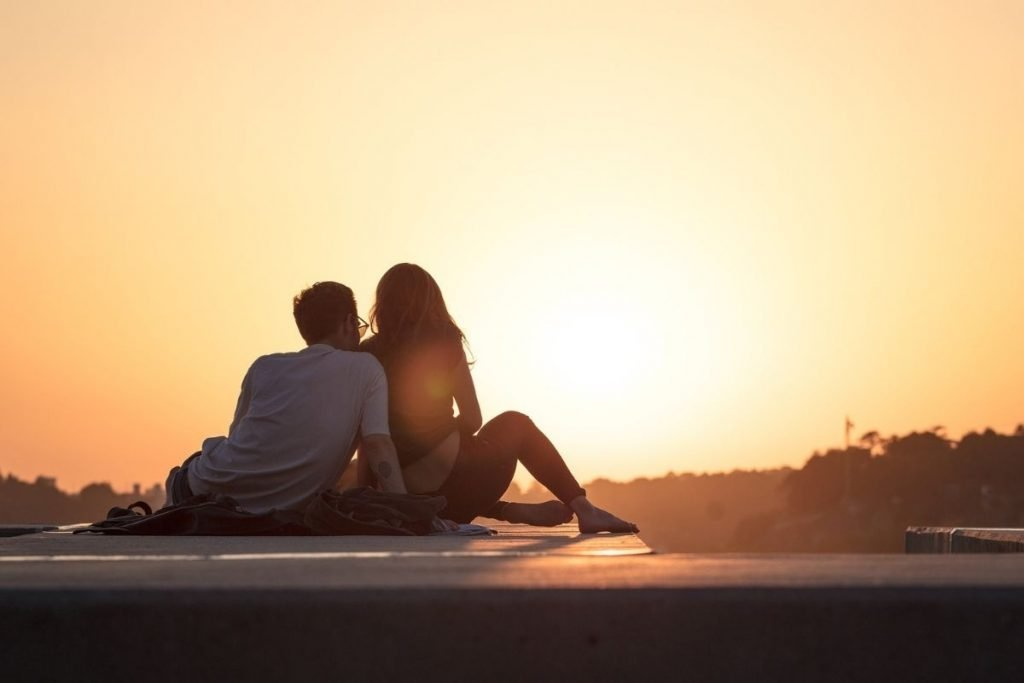 couple relaxing in sunset