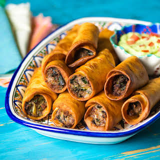 Black Bean, Hatch Chile and Cheddar Flautas with Avocado Cream.