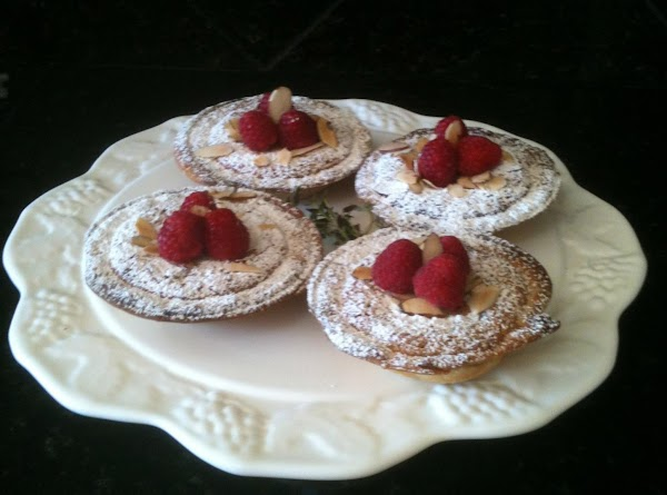 Once cooled, top with confectioners sugar, remaining almonds and raspberries.  Serve warm or at room...