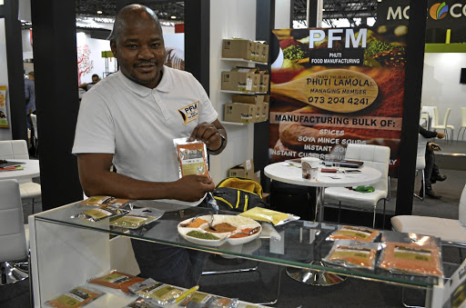 Limpopo spices manufacturer Phuti Lamola with a range of his spices at his company Phuti Food Manufacturing.