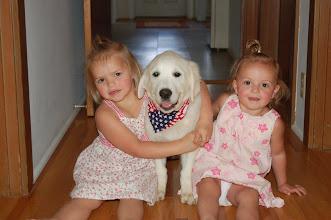 Photo: English Cream Golden Retriever puppy with girls.