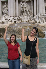 Photo: Katie and Teresa throwing in a coin and making a wish at Trevi Fountain in Rome, Italy